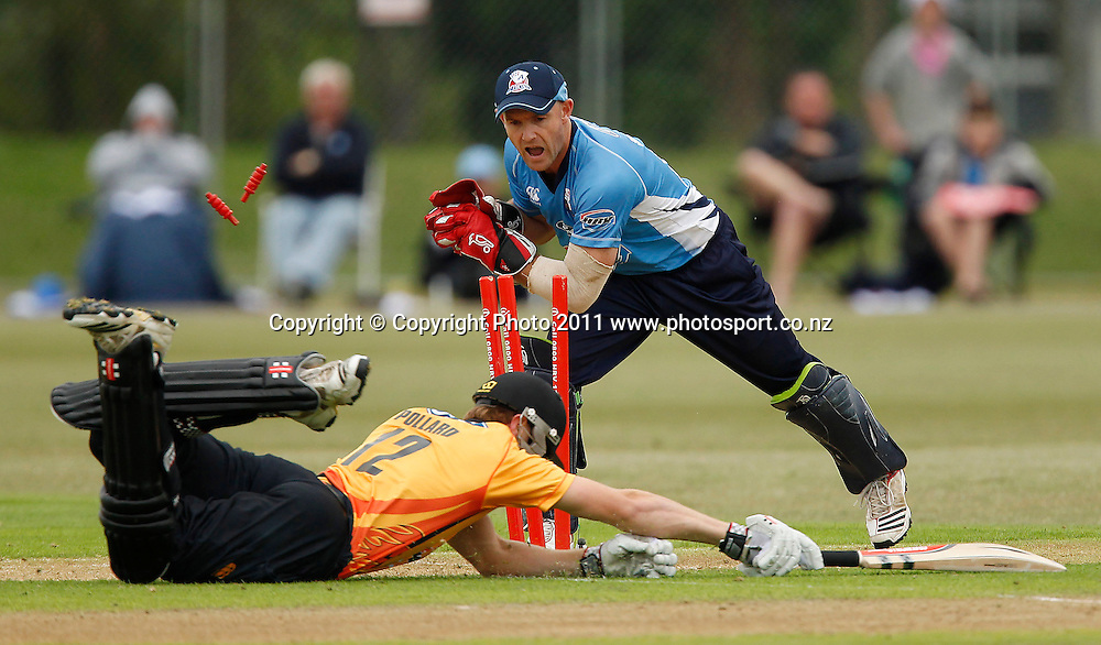 Michael Pollard of the Firebirds makes his ground as Gareth Hopkins of the Aces attempts a run out during the HRV Cup Cricket Twenty-20,  Auckland Aces v Wellington Firebirds, Colin Maiden Park Auckland, Sunday 18 December 2011. Photo: Simon Watts/www.photosport.co.nz