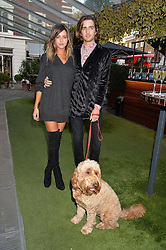 ELEANOR CALDER and MAX HURD with Bruce the dog at the Bluebird's End of Summer Party with Taylor Morris held at Bluebird, 350 King's Road, London on 29th September 2016.