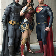 Cosplayers in their costumes, as members of the Justice League is an upcoming American superhero film based on the DC Comics superhero team.<br /> <br /> Left:  Bruce Wayne / Batman: The benefactor of the group of meta-humans, a wealthy socialite and the owner of Wayne Enterprises, who also dedicates himself to protecting Gotham City from its criminal underworld as a highly trained, masked vigilante equipped with many powerful tools and weapons.<br /> <br /> Middle: Diana Prince / Wonder Woman: An antiquities dealer and acquaintance of Wayne who is actually an immortal Amazonian warrior princess from Themyscira and daughter of Zeus, who possesses superhuman attributes and abilities inherited from her parents.<br /> <br /> Right:  Kal-El / Clark Kent / Superman: A Kryptonian survivor and journalist for the Daily Planet with superhuman abilities, who was presumed dead after the events of Batman v Superman: Dawn of Justice.<br /> <br /> <br /> Cosplayers often interact to create a subculture and a broader use of the term &quot;cosplay&quot; applies to any costumed role-playing in venues apart from the stage. Any entity that lends itself to dramatic interpretation may be taken up as a subject and it is not unusual to see genders switched. Favorite sources include manga and anime, comic books and cartoons, video games, and live-action films and television series.