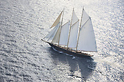 The 2010 Sailing yacht Atlantic is magnificent replica of the 1903 William Gardner designed three-masted sailing schooner Atlantic, owned by Ed Kastelein. The 1903 sailing schooner was a long time World record holder for the crossing of the Atlantic Ocean under sail in 1905 winning the KaiserÕs Cup from New York to The Lizard. The record held firm for almost a century, when it was broken in 1998. It is the longest standing speed record in the Yachting History. .The Owner, Ed Kastelein is the man responsible for the recreation of this wonderful new schooner Atlantic, and is also behind such projects as the sailing yacht Thendara, sailing yacht Aile Blanche, sailing yacht Borkumriff, sailing yacht Zaca a te Moana and most recently the Herreshoff racing schooner Eleonora E...The Dutch Van der Graaf yard first launched the Sailing Yacht Atlantic in 2008. Following her launch, she underwent an extensive programme of fitting out. 2009 saw the assembly of her three masts, with a height of 45 metres, supporting 1700m? of sails. Her raven black high gloss hull reflects the ripples of the water and one glance at the three towering masts, instantly give the sense of power that this mighty yacht Atlantic has...Sailing schooner Atlantic is the largest classic sailing schooner ever created, measuring 185 feet (56 metres) over deck and with the bowsprit to boom length of 227 feet (69 metres). Her graceful sheerline and long overhangs accentuate her grace while her waterline length of 42 meters and narrow beam are a promise for unmatched speed under sail...On June 23rd 2010, sailing schooner Atlantic sailed out to sea, three years after her keel was laid. The Owner, Ed Kastelein, saw his long term dream come true, as he witnesses his family, guest and crew step on board of Atlantic yacht. Her maiden voyage was a two month leisurely cruise from Rotterdam to Cannes and she exceeded all expectations, sailing fast at every point of sail with amazing ease and comfort.Yacht Charter Accom