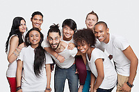 Portrait of cheerful young multi-ethnic friends against white background