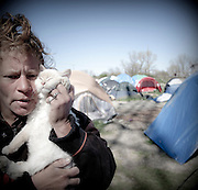 Renee Hudley, and her cat Baby E live in a homeless encampment known as 'tent city'  on the banks of the American River in Sacramento, CA.