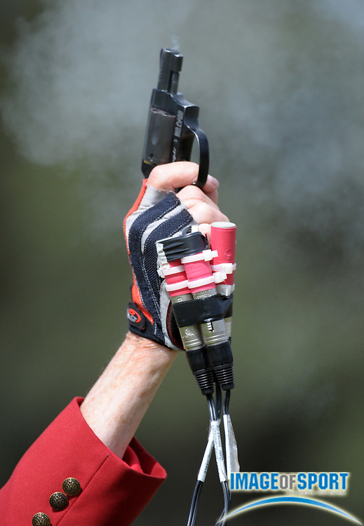 May 26, 2012; Claremont, CA, USA; General view of USA Track & Field official Beverly Lewis firing the starters pistol during the 2012 NCAA Division III Track & Field Championships at Claremont-Mudd-Scripps College.