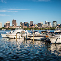 Boston Skyline Charles River boats photo. Boston Massachusetts is a major city in the Eastern United States of America.