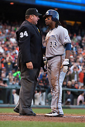 July 23, 2011; San Francisco, CA, USA;  Milwaukee Brewers second baseman Rickie Weeks (23) argues with MLB umpire Sam Holbrook (34) after getting called out at home plate against the San Francisco Giants during the fourth inning at AT&T Park.