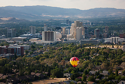 """Balloon Over Reno 5"" - This hot air balloon was photographed flying over Reno, Nevada during the 2011 Great Reno Balloon Race. Photographed from a hot air balloon."