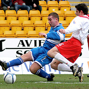 St Johnstone's Peter McDonald and Airdrie Utd's Stuart Taylor in action in the Scottish First Division match played at Mc Diarmid Park 20th January 2007.