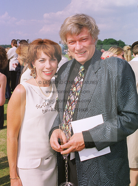Writer KATHY LETTE and her husband MR GEOFFREY ROBERTSON QC, at a polo match in Berkshire on 13th June 1999.MTD 162