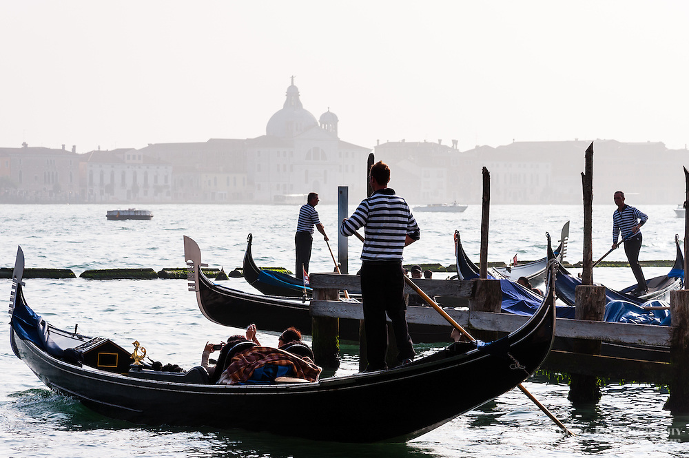 Italy, Venice. Gondoliers at work.