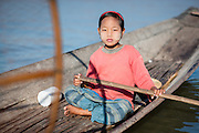 Fishing girl on her boat in Inle Lake (Myanmar)