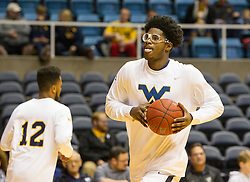 Nov 23, 2015; Morgantown, WV, USA; West Virginia Mountaineers forward Devin Williams warms up before their game against the Bethune-Cookman Wildcats at WVU Coliseum. Mandatory Credit: Ben Queen-USA TODAY Sports