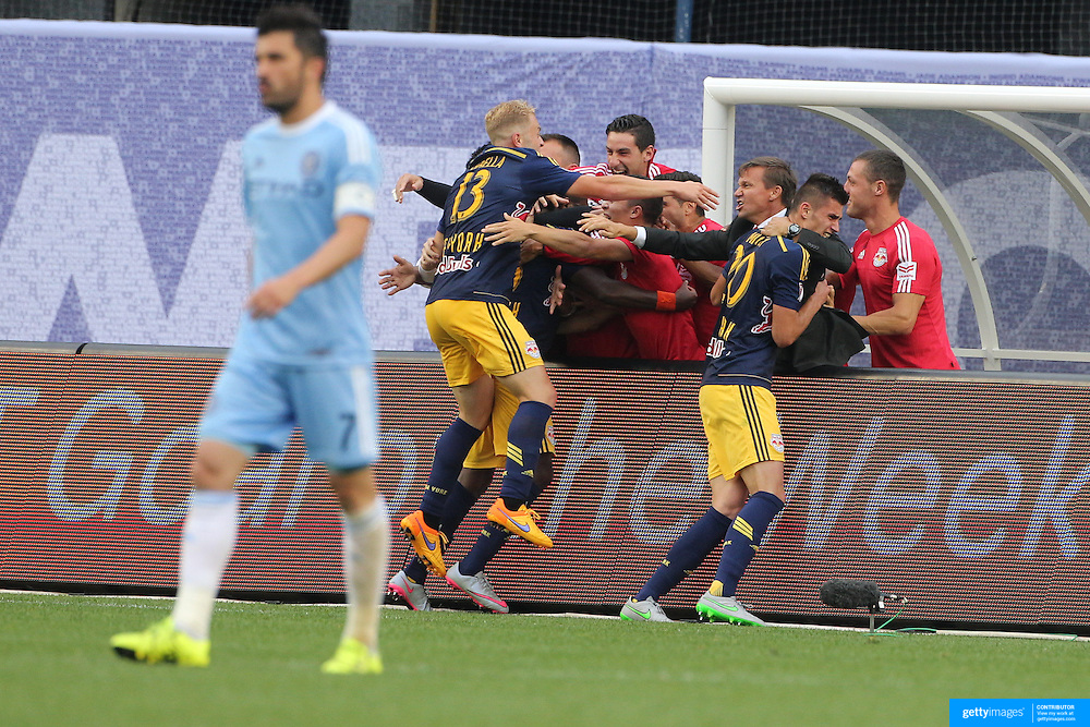 New York Red Bulls Manager Jesse Marsch, (center), celebrates with his players after Chris Duvall, New York Red Bulls, scored his sides second goal while David Villa, (left), NYCFC, walks away during the New York City FC Vs New York Red Bulls, MSL regular season football match at Yankee Stadium, The Bronx, New York,  USA. 28th June 2015. Photo Tim Clayton