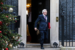 © Licensed to London News Pictures. 18/12/2017. London, UK. Secretary of State for Exiting the European Union David Davis leaves 10 Downing Street after a special Cabinet meeting. Photo credit: Rob Pinney/LNP
