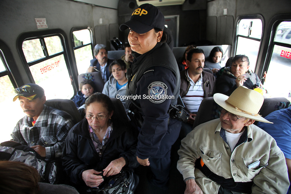 A U.S. Customs and Border Protection agent checks a bus carrying passengers into Tijuana, Mexico at the San Ysidro border crossing in San Diego, California on April 30, 2010. The US government has stepped up inspections of vehicles crossing over to Mexico in an attempt to try to slow the flow of drug proceeds into Mexico. (Photo/Scott Dalton)