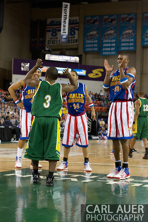 April 30th, 2010 - Anchorage, Alaska:  The Globetrotters (from left to right, Prince Perez, Handles Franklin, and Hi-Lite Bruton make fun of the shortest Washington General.