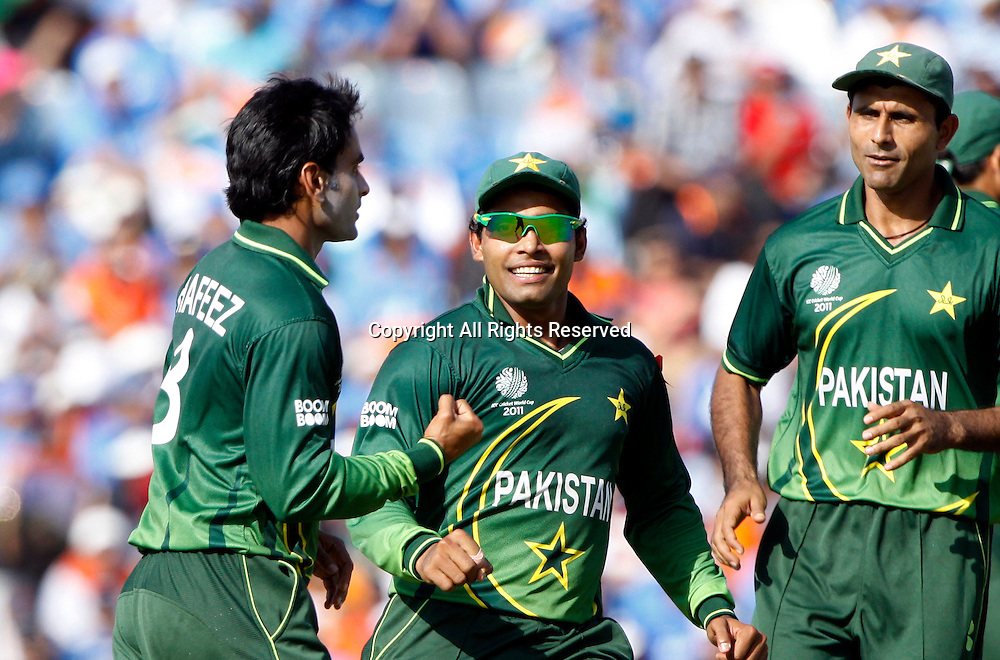 30.03.2011 Cricket World Cup from the Punjab Cricket Association Stadium, Mohali in Chandigarh. India v Pakistan. Mohammad Hafeez of Pakitan celebrates the wicket of Gautam Gambhir during the match of the ICC Cricket World Cup between India and Pakistan.