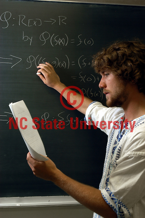 PAMS math student Boone works out a problem.   PHOTO BY ROGER WINSTEAD