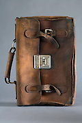 old weathered leather briefcase placed on its side