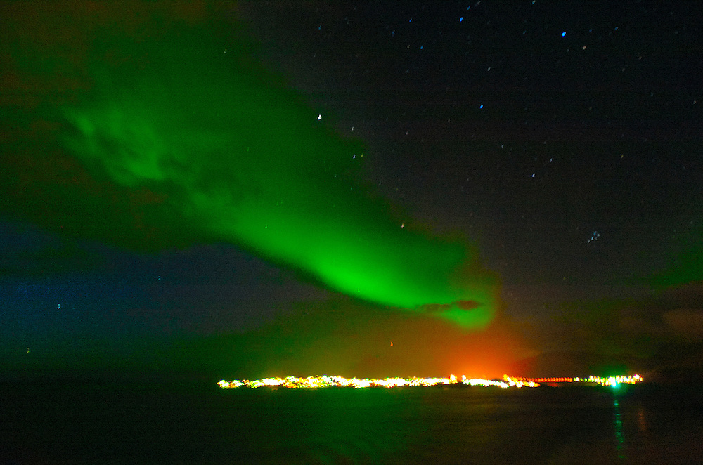 """The Aurora Borealis, or Northern Lights, shines above the Arctic sea, Greenland. Greenland (Greenlandic: Kalaallit Nunaat, meaning """"Land of the Kalaallit (Greenlanders) is a self-governing Danish province located between the Arctic and Atlantic Ocean. A recent study by researchers from NASA's Goddard Space Flight Center shows that Greenland's ice sheet, about 8% of the Earth's grounded ice, is losing ice mass."""