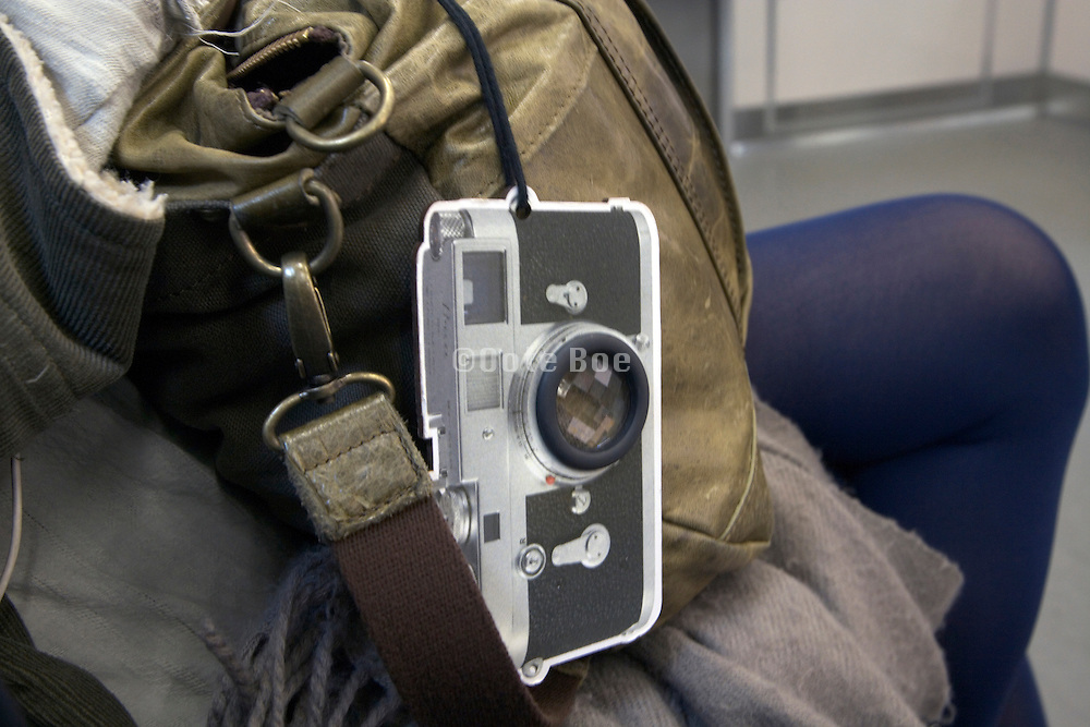traditional Leica range finder camera hanger on a backpack bag