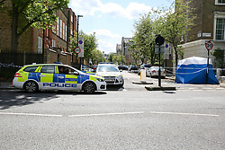 © Licensed to London News Pictures. 12/05/2019. London, UK. A forensics tent on Tollington Road, on junction of Annette Road, Islington in north London as Met police launch an investigation into the death of a man who was found in a wheelie bin behind a Waitrose store shortly before 4pm on Saturday 11 May 2019. Photo credit: Dinendra Haria/LNP