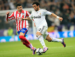MADRID, SPAIN - Sunday, March 28, 2010: Real Madrid Club de Futbol's Marcelo Vieira da Silva Junior and Club Atletico de Madrid's Jose Antonio Reyes during the La Liga Primera Division Madrid Derby match at the Estadio Santiago Bernabeu. (Pic by Hoch Zwei/Sprimont Press/Propaganda)
