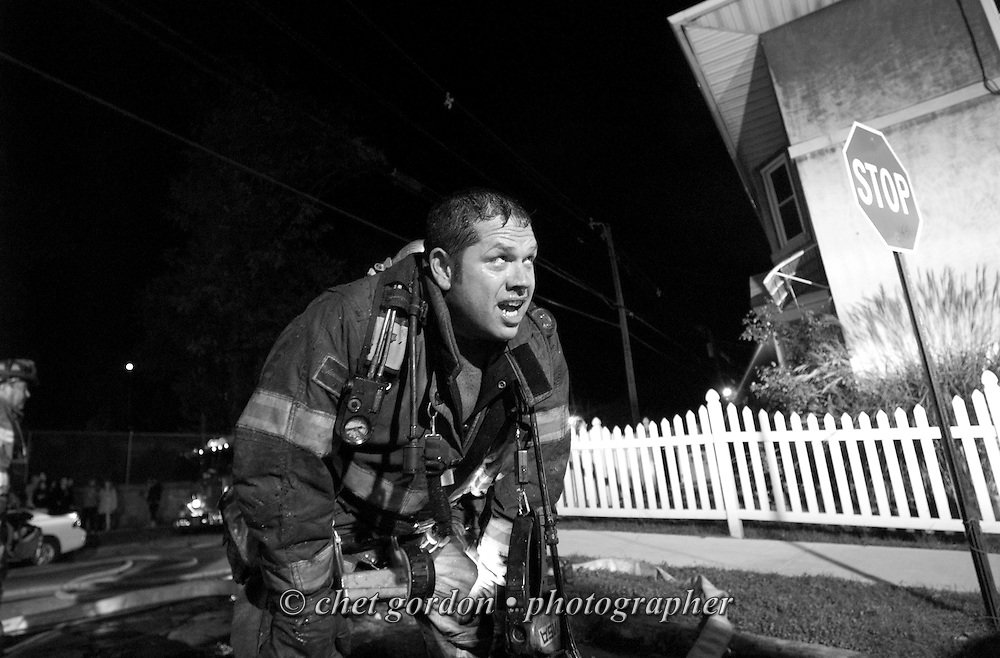 Newburgh firefighter Dan Rhode gasps for air as he views the scene after fighting a three-alarm fire at 488 Liberty Street in Newburgh, NY on Sunday, October 23, 2011. Nearly a dozen people were left homeless after the fire erupted in the multi-family home when a resident was cooking in a second-floor apartment in the rear of the building. All the occupants got out safely and there were no injuries.  CHET GORDON/Times Herald-Record
