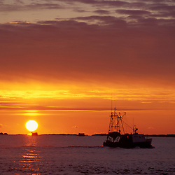 Fishing boat on the Atlantic Ocean at sunrise.  New Hampshire Seacoast.  Odiorne State Park, Rye, NH