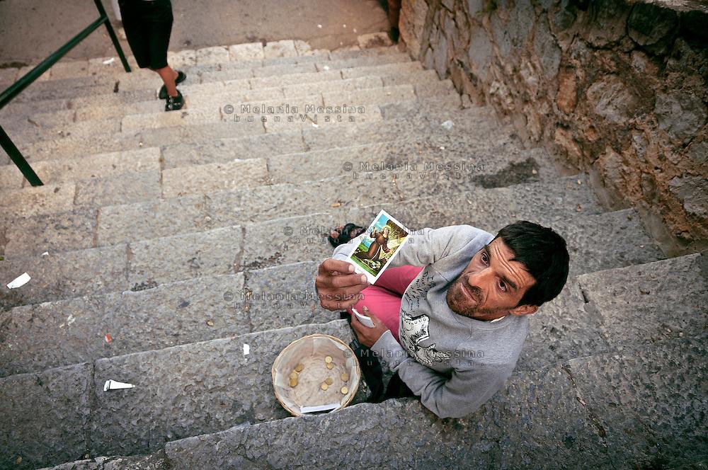 Palermo, sanctuary of Saint Rosalia, a man asking for charity .<br /> Palermo, santuario di Santa Rosalia, mendicante chiede la carit&agrave;.