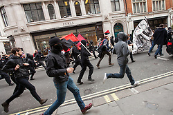 "© Licensed to London News Pictures . 20/10/2012 . London , UK . Black Bloc protesters break away from the main march and run along Regent Street . The TUC march in London against austerity and cuts , under the banner "" March for a future that works "" . Photo credit : Joel Goodman/LNP"