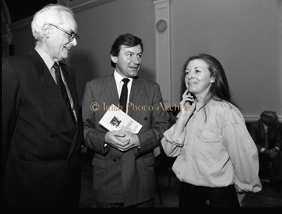 """These Obstreperous Lassies"" Book Launch.  (R93)..1988..15.12.1988..12.15.1988..15th December 1988..A book which chronicles an important aspect of Irish social history was launched in Larkin Hall. ""These Obstreperous Lassies"" written and researched by Mary Jones, details the seventy three years of the Irish Women Workers Union and of the women who were involved in the union..With Countess Markievicz as its first president, The Union began the fight for equal pay and fair treatment under the leadership of women like helen Chenevix, Louise Bennett and Helena Molloy. They fought for the rights of vulnerable workers such as Laundresses,print workers,box makers,nurses and dressmakers..The Author, Mary Jones, is a full time researcher specialising in Women and Work...Picture shows the Author Mary Jones chatting with John Horgan, Chairman of the Labour Court and (an un-named) a gentleman on the left."