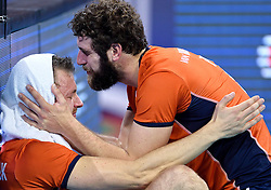 Jeroen Rauwerdink #10 and  Yannick van Harskamp #2 disappointed after the volleyball match between National teams of Netherlands and Slovenia in Playoff of 2015 CEV Volleyball European Championship - Men, on October 13, 2015 in Arena Armeec, Sofia, Bulgaria. Photo by Ronald Hoogendoorn / Sportida