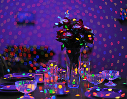 "© Licensed to London News Pictures. 07/02/2012, London, UK. A detail of a dining table in ""I'm Here, But Nothing 2000/2012' The installation is made up of vinyl stickers, ultraviolet fluorescent lights, furniture and household objects. Press preview of Yayoi Kusama at the Tate Gallery Bankside today 7th February 2012. The exhibition spans six decades of the artists work. Kusama is one of Japan's best known living artists.  Photo credit : Stephen Simpson/LNP"