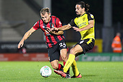 Burton Albion midfielder Ryan Edwards challenges Bournemouth midfielder Ryan Fraser during the EFL Cup match between Burton Albion and Bournemouth at the Pirelli Stadium, Burton upon Trent, England on 25 September 2019.