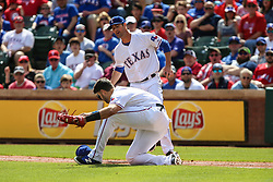 March 29, 2018 - Arlington, TX, U.S. - ARLINGTON, TX - MARCH 29: Texas Rangers first baseman Joey Gallo (13) tries to field a ball as Texas Rangers starting pitcher Cole Hamels (35) leaps over the baseball during the game between the Texas Rangers and the Houston Astros on March 29, 2018 at Globe Life Park in Arlington, Texas. Houston defeats Texas 4-1. (Photo by Matthew Pearce/Icon Sportswire) (Credit Image: © Matthew Pearce/Icon SMI via ZUMA Press)
