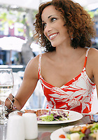 Woman at outdoor cafe smiling