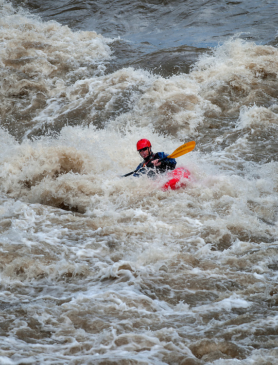 em051617d/jnorth/Adam Quinn, with the Santa Fe County Fire Department, kayaks through the Souse Hole Rapid on the Rio Grande Racecource on his day off, Tuesday May 16, 2017. The river is running at over 3100 cubic feet per second, almost twice its average.  (Eddie Moore/Albuquerque Journal