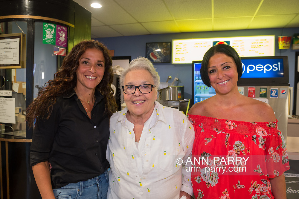 """Bellmore, New York, USA. 19th July 2017. At center, LISA CAPUTO, who's the older sister of comedian Lou DiMaggio, poses with her twin daughters (left) LISA and (R) LAUREN, at Long Island International Film Expo LIIFE 2017, after the Documentary """"Where Have You Gone, Lou DiMaggio?"""" screened. Caputo came from Lake Ronkonkoma to see the feature film about - """"Louie"""" as she calls her brother - DiMaggio contemplating a comeback after being away from the stage for 20 years."""