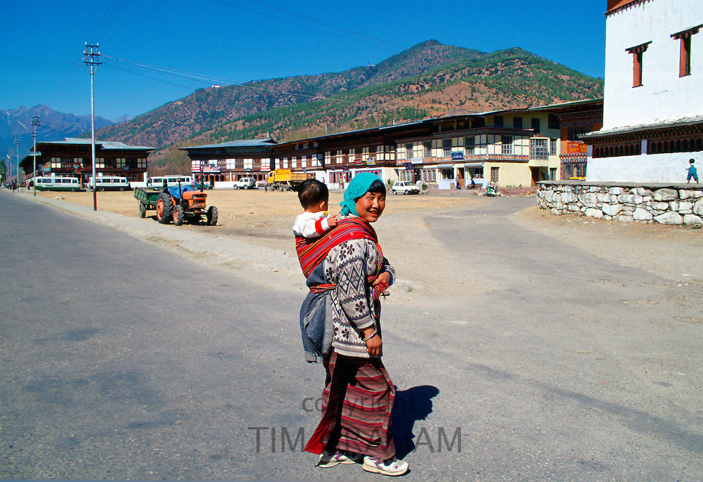 Woman with child in sling, Paro, Bhutan