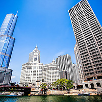 Picture of Chicago buildings at Michigan Avenue Bridge. Photo includes Michigan Avenue Bridge (DuSable Bridge), Chicago River, Trump Tower, Wrigley Building, and the Equitable Building. Photo is high resolution and was taken in 2010.