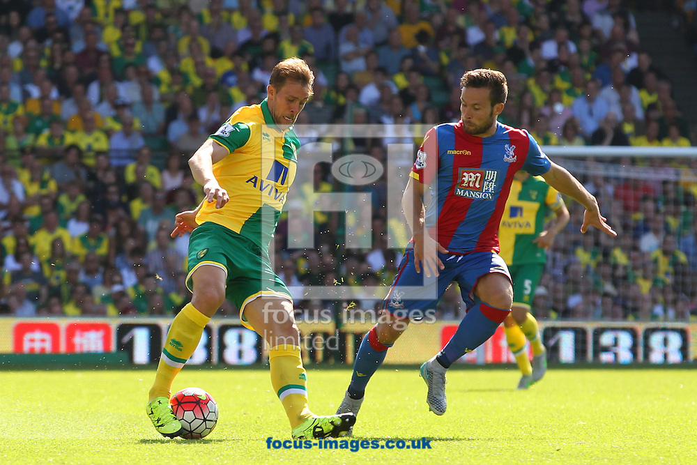 Steven Whittaker of Norwich and Yohan Cabaye of Crystal Palace in action during the Barclays Premier League match at Carrow Road, Norwich<br /> Picture by Paul Chesterton/Focus Images Ltd +44 7904 640267<br /> 08/08/2015