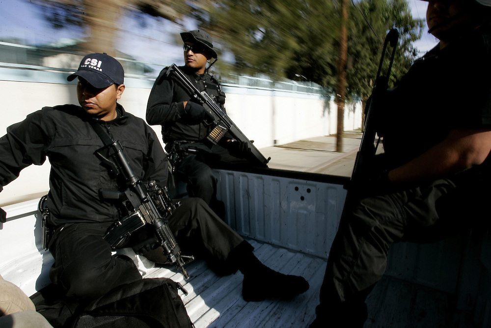 Tijuana Police agents in route to search a home for illegal contraband during a drug sweep in Colonia Chula Vista in Tijuana, Mexico