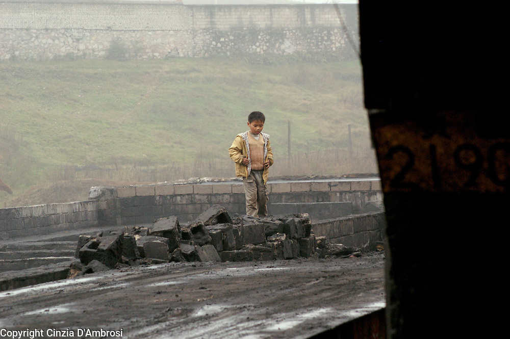 Children of coal miners are helping out, often at an early age. Surface mining in Wangjazhai, China