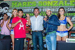CARSON, California/USA (Thursday, Aug 22 2013) - Three-Time and Three-Division World Champion Abner Mares (26-0-1, 14 KO's), of Hawaiian Gardens, (red t-shirt) and former Two-Division World Champion Jhonny Gonzalez (54-8, 46 KO's), of Mexico City face-off during the last Mares vs Gonzalez press conference at The SubHub Center in Carson, CA.  PHOTO © Eduardo E. Silva/SILVEXPHOTO.COM.