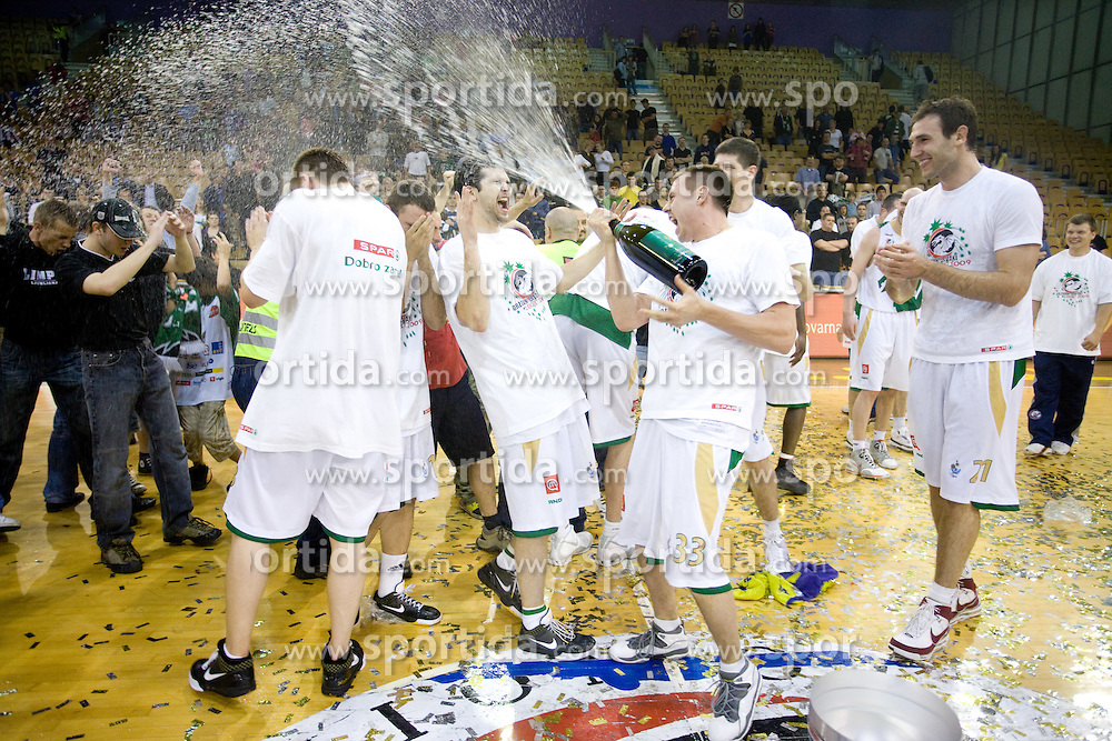 Saso Ozbolt and Aleksej Nesovic celebrate at third finals basketball match of Slovenian Men UPC League between KK Union Olimpija and KK Helios Domzale, on June 2, 2009, in Arena Tivoli, Ljubljana, Slovenia. Union Olimpija won 69:58 and became Slovenian National Champion for the season 2008/2009. (Photo by Vid Ponikvar / Sportida)