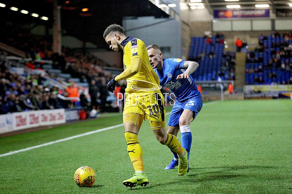 Peterborough United midfielder Joe Ward (15)  and Oxford United's Marcus Browne (10) during the EFL Sky Bet League 1 match between Peterborough United and Oxford United at London Road, Peterborough, England on 8 December 2018.