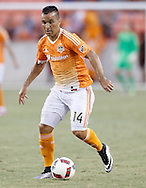 Jun 29, 2016; Houston, TX, USA; Houston Dynamo midfielder Alex (14) dribbles against the Sporting Kansas City in the second half at BBVA Compass Stadium. Dynamo won 3 to 1. Mandatory Credit: Thomas B. Shea-USA TODAY Sports