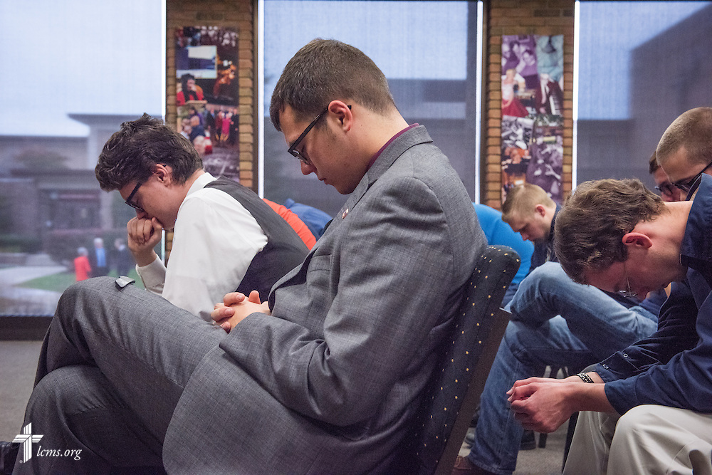 Pre-Seminary Program students pray with the Rev. Dr. Matthew C. Harrison, president of The Lutheran Church–Missouri Synod, during a brief meeting on the university campus in River Forest, Ill., on Sunday, Oct. 12, 2014. LCMS Communications/Erik M. Lunsford