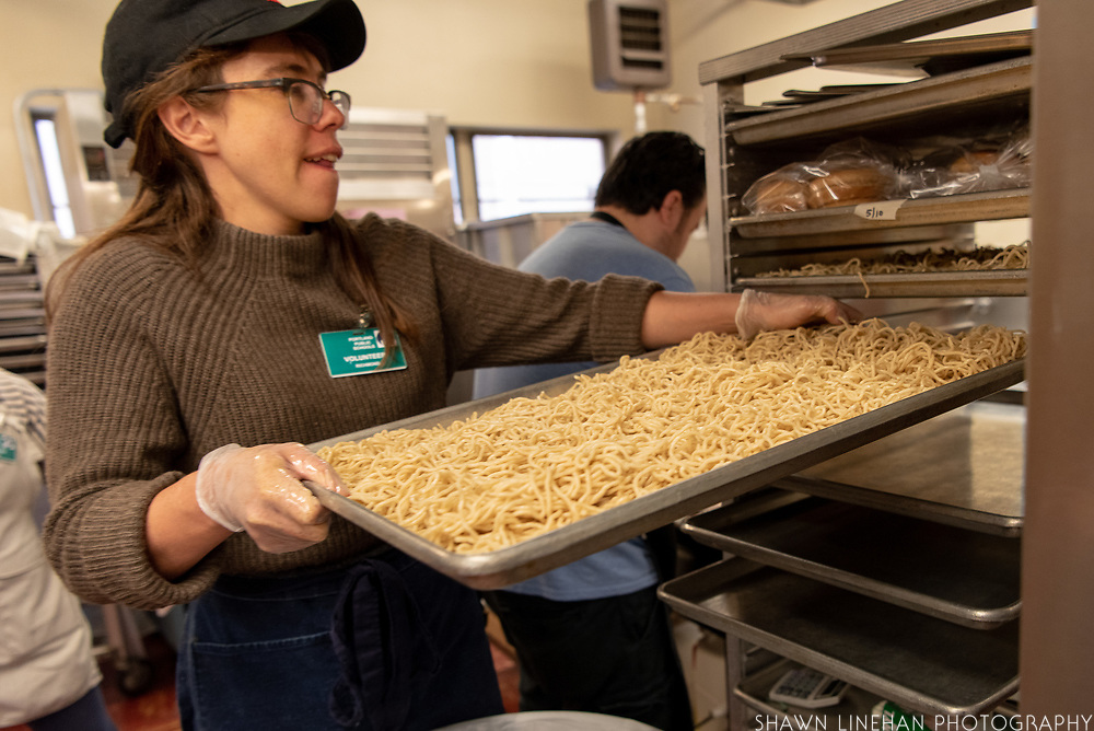Lola Milholland serves her Umi Noodles in the Portland Public Schools.