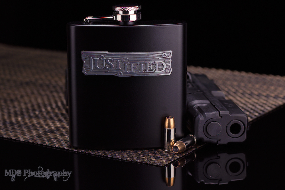 Justified Limited Edition Whiskey flask and smoking gun with hollow point bullets. <br />